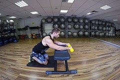 Palms-down dumbbell wrist curl over a bench